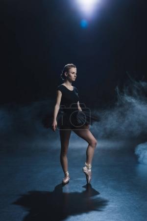 Ballerina dancing in black tutu