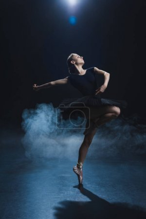 ballerina dancing in black tutu