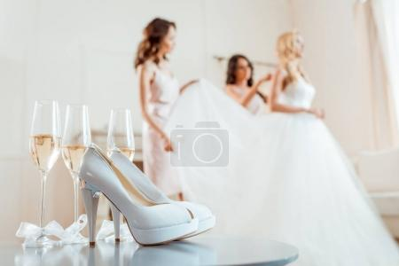 High heels and champagne with bride with bridesmaids