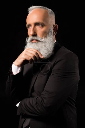 businessman thoughtfully touching beard