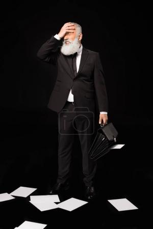 businessman placing hand across face