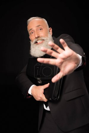 businessman guarding off with hand