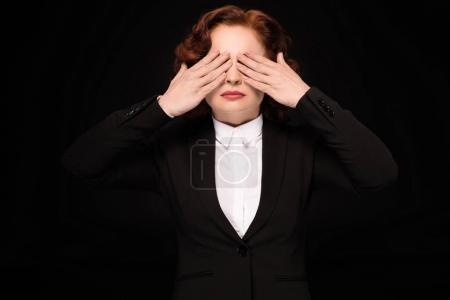 Photo for Half-length shot of businesswoman in a suit covering her eyes with her hands - Royalty Free Image