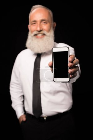 man showing smartphone screen