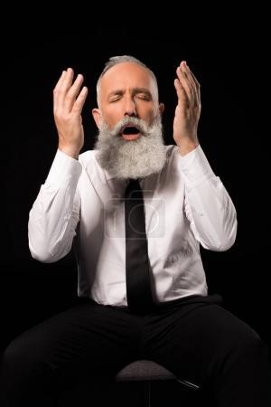 Man throwing hands up