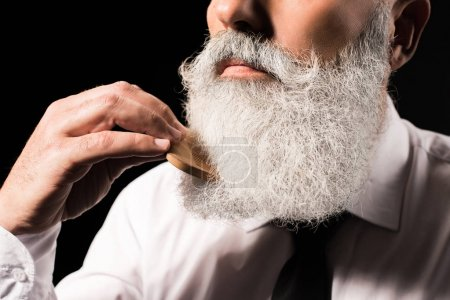 Photo for Cropped shot of a man combing his long beard - Royalty Free Image