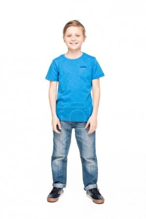 Photo for Full length view of cute little boy in jeans and blue t-shirt smiling at camera isolated on white - Royalty Free Image