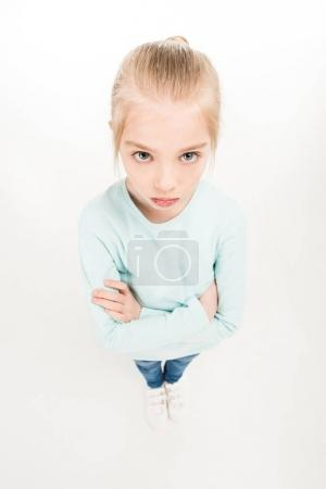 Serious child with crossed arms