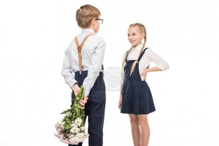 boy presenting flowers to girl