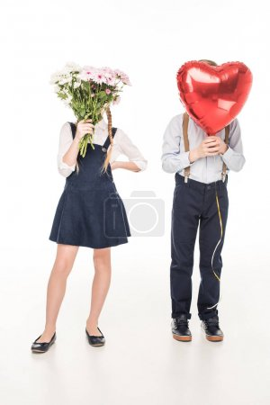 children with flowers and balloon