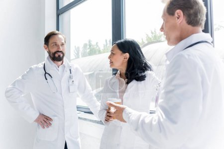doctors talking and drinking coffee