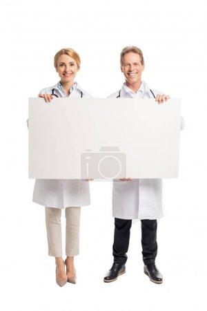 Doctors holding blank banner
