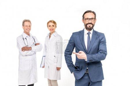 confident businessman and doctors
