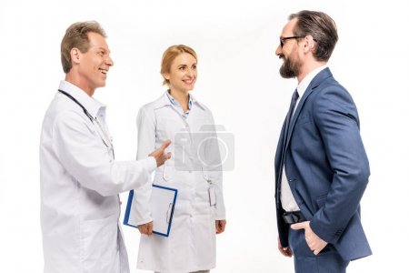 smiling businessman and doctors