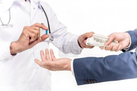 businessman buying drug from doctor