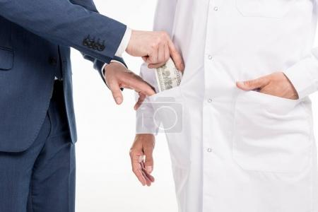 businessman giving bribe to doctor