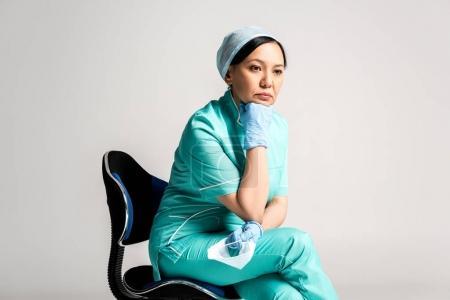 pensive asian doctor