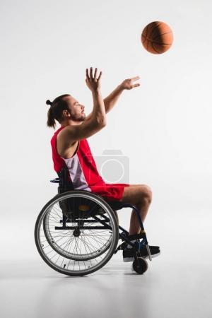 Photo for Disabled young sportsman in wheelchair throwing a basketball ball isolated on white - Royalty Free Image