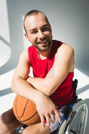 Hadicapped sportsman holding basketball