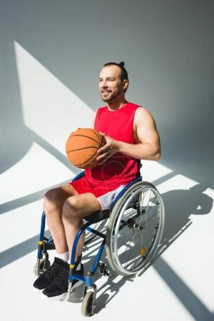 Hadicapped sportsman with basketball ball