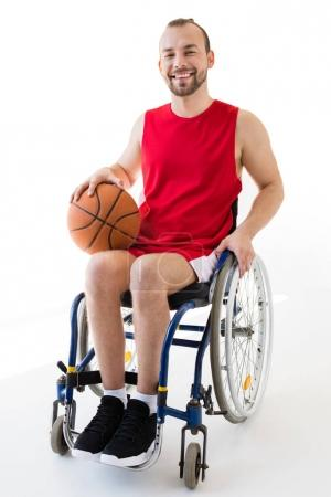 Disabled sportsman holding basketball ball