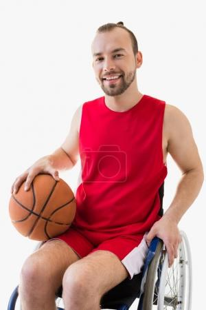 sportsman in wheelchair with basketball ball