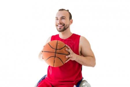 sportsman in wheelchair throwing ball