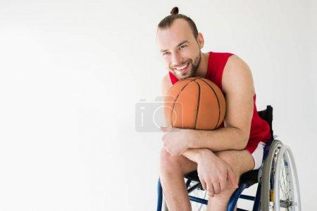 Disabled sportsman holding basketball