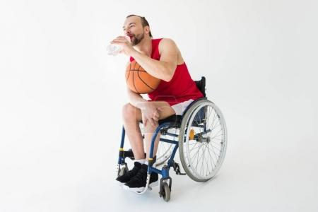 Disabled basketball player drinking water