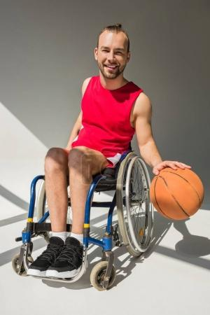Disabled sportsman playing basketball