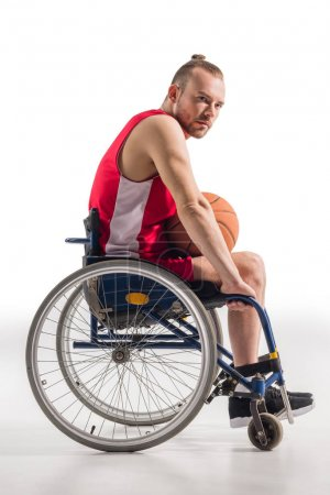 sportsman in wheelchair with basketball