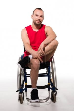 Smiling sportsman in wheelchair