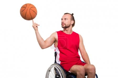 sportsman in wheelchair playing with basketball