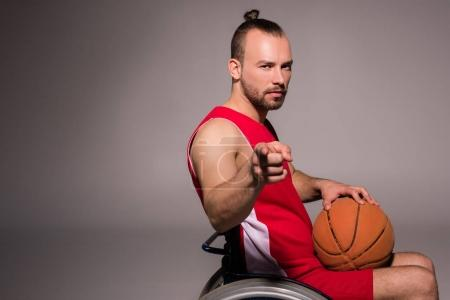 Disabled basketball player pointing finger