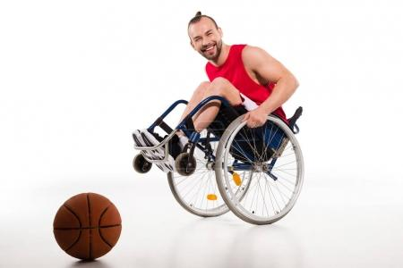 Smiling basketball player in wheelchair