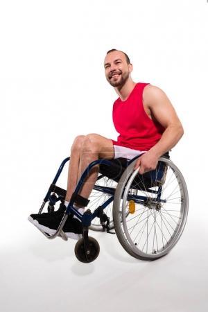 Smiling sportsman in wheelchair