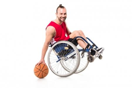 sportsman in wheelchair playing basketball
