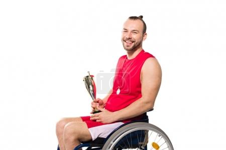 sportsman in wheelchair holding trophy