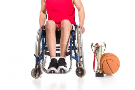 Sportsman in wheelchair with trophies