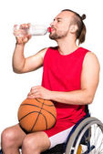 Disabled sportsman drinking water