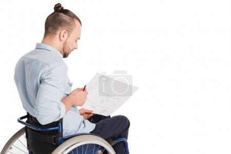disabled architect with blueprints
