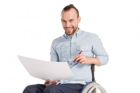 disabled man working with papers