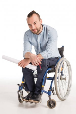 disabled man holding papers