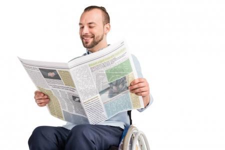 Man in wheelchair reading newspaper