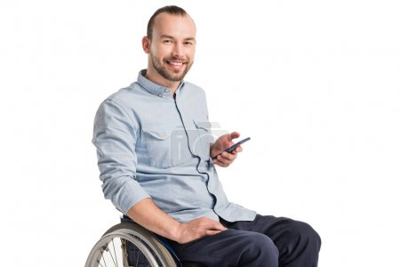 man in wheelchair with smartphone
