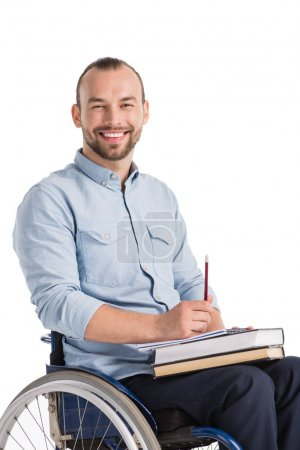 man on wheelchair with books