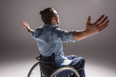 Disabled man with arms outstretched