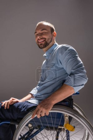 Smiling man in wheelchair
