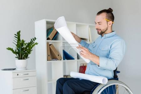 Disabled businessman looking at documents