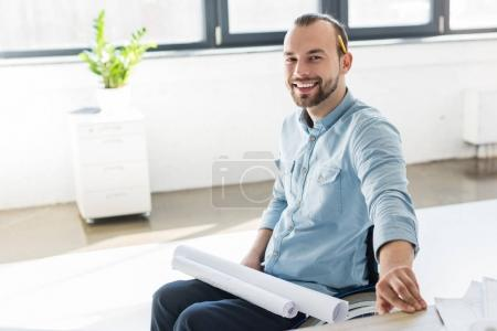 Disabled architect holding blueprints